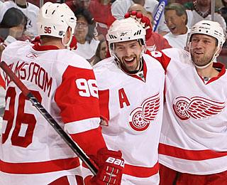 Pavel Datsyuk celebrates the go-ahead goal with Tomas Holmstrom and Brian Rafalski. (Getty Images)