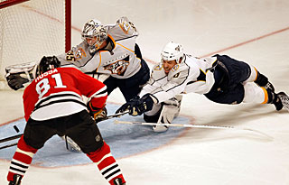 Neither Pekka Rinne nor Shea Weber react in time to stop Marian Hossa from scoring. (AP)