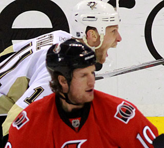 A photo that speaks volumes: Jordan Staal (11) is ecstatic, while Shean Donovan (10) is not. (AP)