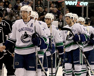Henrik Sedin leads the handshake procession for Vancouver after its series victory.  (Getty Images)