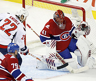 Jaroslav Halak, who falls just short of his first playoff shutout, makes one of his 53 saves at the net.  (AP)