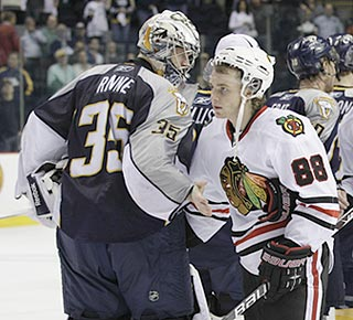 Patrick Kane, one of Chicago's five goal scorers, shakes hands with Nashville goalie Pekka Rinne.  (AP)