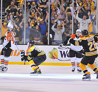 Marc Savard is pumped, fans are ecstatic, teammates are thrilled and the Flyers are in shock.  (Getty Images)