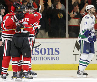 Ryan Kesler (right) is in no mood for celebrations as his Canucks melt down after a strong opening period.  (AP)