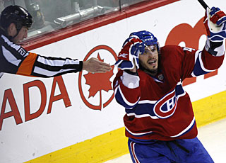 The official points to the puck as Maxim Lapierre ties it a 2 for the Canadiens with his second playoff goal. (AP)