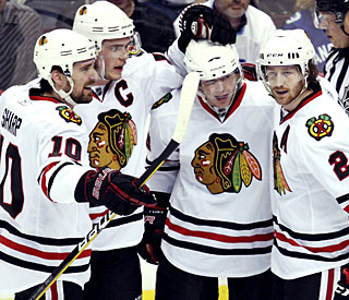 Jonathan Toews (second left) and the Blackhawks know they have this series within grasp. (AP)