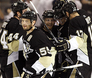 Sergei Gonchar (55) enjoys his goal in the second period with his teammates. (Getty Images)