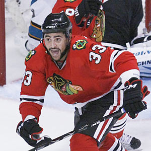 Dustin Byfuglien (three go-ahead goals) is one reason why the Blackhawks are just too difficult to defeat ... even once. (AP)