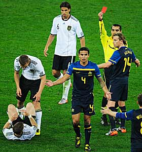 Tim Cahill (4) is the victim of a cheap red card thanks to some skillful acting. (Getty Images)