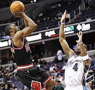 Ben Gordon builds up a sweat by shooting over Antawn Jamison during his ineffectual first quarter.  (AP)