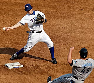 Ian Kinsler does it with his glove, as well as his bat in the Rangers win over the Blue Jays. (AP)