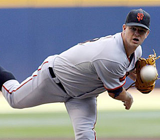 Matt Cain works seven innings, striking out five and picking up his 13th win of the season. (AP)
