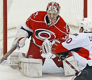 Cam Ward makes one of his 31 saves to help the Hurricanes win consecutive games.  (AP)