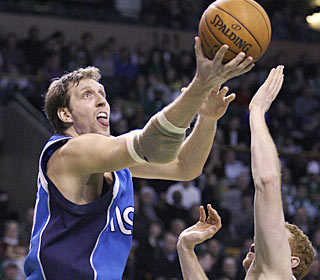 Dirk Nowitzki nets a game-high 37 points, including nine in a row in the third, to power the Mavs.  (AP)