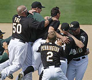 In the middle of the pile is Ryan Sweeney, the A's hero with the game-winning single. (AP)