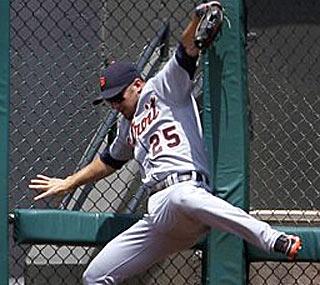 Ryan Raburn crashes through the wall during Jhonny Peralta's inside-the-park homer.  (AP)