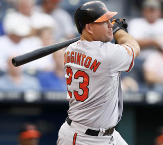 Ty Wigginton snaps the O's five game losing streak with his sacrifice fly in the 11th. (AP)